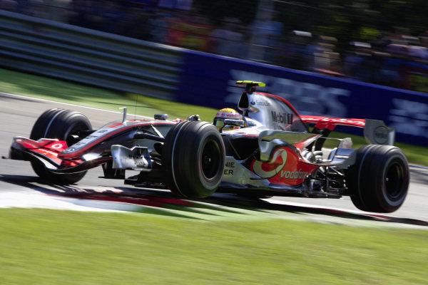 Lewis Hamilton, McLaren MP4-22 Mercedes bouncing over the kerbs.