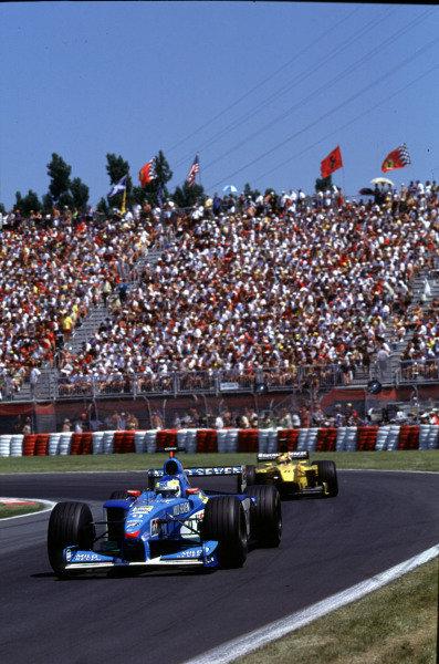 1999 Canadian Grand Prix.Montreal, Quebec, Canada.11-13 June 1999.Giancarlo Fisichella (Benetton B199 Playlife) followed by Heinz-Harald Frentzen (Jordan 199 Mugen Honda).Ref-99 CAN 11.World Copyright - LAT Photographic