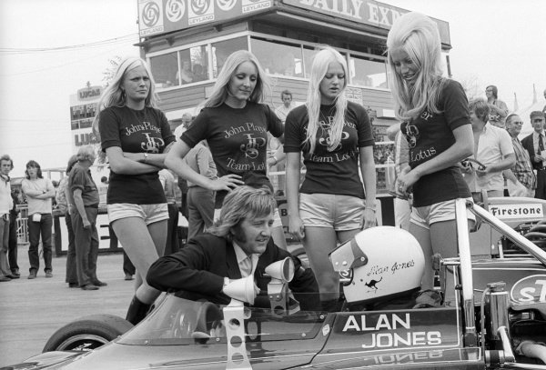 An eye for talent: The JPS girls focus their attention on Alan Jones (AUS), who was competing in the supporting F3 race. British Grand Prix, Rd 9, Silverstone, England, 14 July 1973.