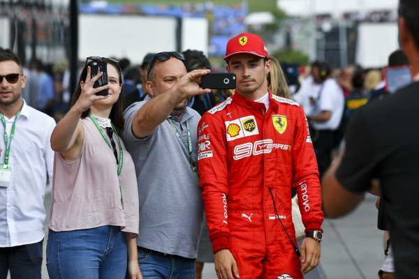 Charles Leclerc, Ferrari, has his photo taken with fans