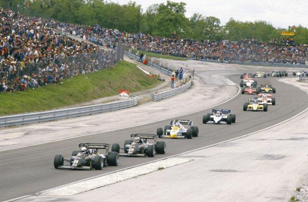 Elio de Angelis, Lotus 95T Renault, leads Nigel Mansell, Lotus 95T Renault, Keke Rosberg, Williams FW09 Honda, Nelson Piquet, Brabham BT53 BMW, Derek Warwick, Renault RE50, Alain Prost, McLaren MP4-2 TAG, Michele Alboreto, Ferrari 126C4, Manfred Winkelhock, ATS D7 BMW, and Ayrton Senna, Toleman TG184 Hart.