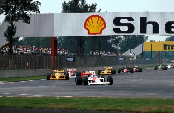 Race winner Alain Prost (FRA) McLaren MP4/4 leads Nelson Piquet (BRA) Lotus 100T on the first lap.  The altitude benefited the turbos who held the first six places. 