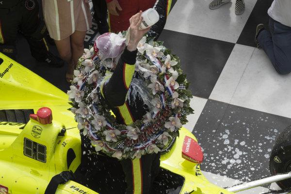 Simon Pagenaud, Team Penske Chevrolet, pours milk over his head in victory lane.