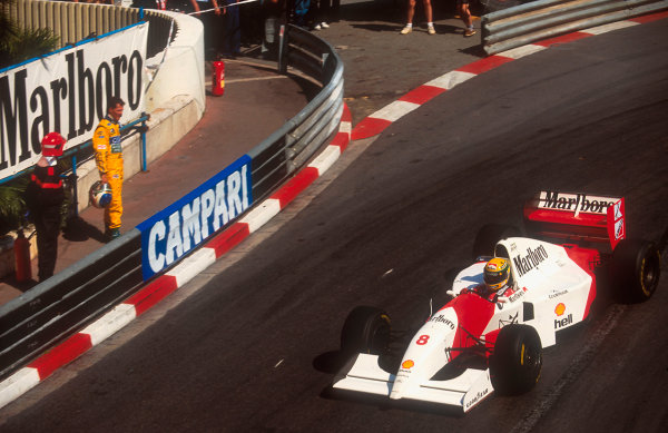 1993 Monaco Grand Prix.Monte Carlo, Monaco.20-23 May 1993.Ayrton Senna (McLaren MP4/8 Ford) watched by Michael Schumacher (Benetton Ford) after his retirement.Ref-93 MON 01.World Copyright - LAT Photographic