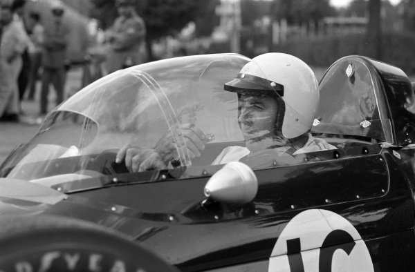 Jack Brabham eating an ice cream in the Brabham BT24 Repco.