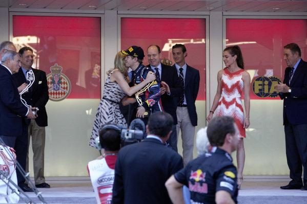 Charlene Wittstock - HSH Prince Albert II's fiance, kisses Sebastian Vettel, 1st position, on the podium.