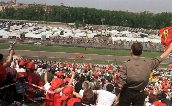 1998 San Marino Grand Prix.Imola, Italy.24-26 April 1998.The Tifosi greet Michael Schumacher (Ferrari F300) after he qualified third.World Copyright - LAT Photographic