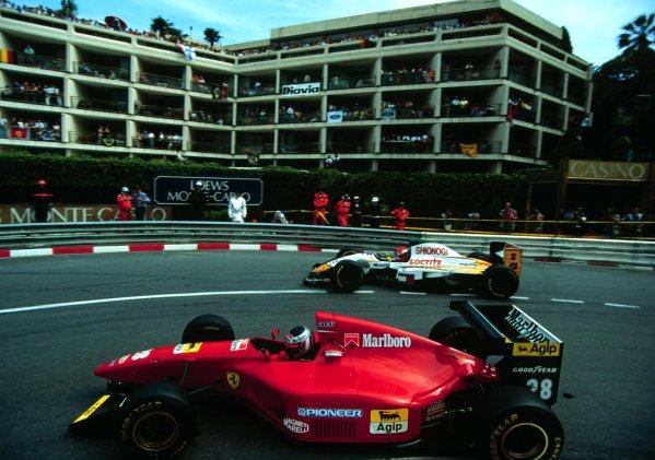 1994 Monaco Grand Prix.Monte Carlo, Monaco.12-15 May 1994.Gerhard Berger (Ferrari 412T1) overtakes Johnny Herbert (Lotus 107C Mugen-Honda) at Loews Hairpin. Berger finished in 3rd position.World Copyright - LAT Photographic