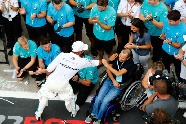 Lewis Hamilton, Mercedes AMG F1, 1st position, celebrates with team members.