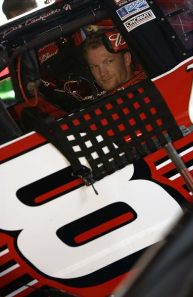 NASCAR Winston Cup EA Sports 500, Talladega Superspeedway, Talladega, Alabama, USA 6 October,2002Dale Earnhardt, Jr. waits in his car as adjustments are made during practice.Copyright-F Peirce Williams/MMP-Inc. 2002 LAT Photographic