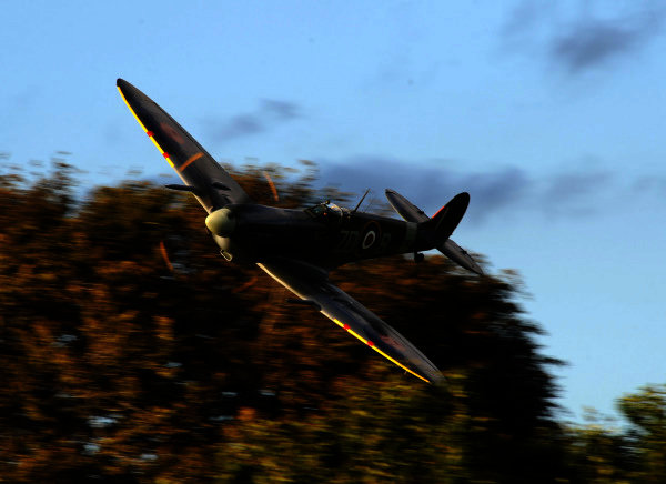 Goodwood Estate, West Sussex 16th  - 19th September  2010. Supermarine Spitfire Mk.IXc MH434 of the Old Flying Machine Company drops in below the tree line. Atmosphere World Copyright: Jeff Bloxham/LAT Photographic. Ref: Digital Image