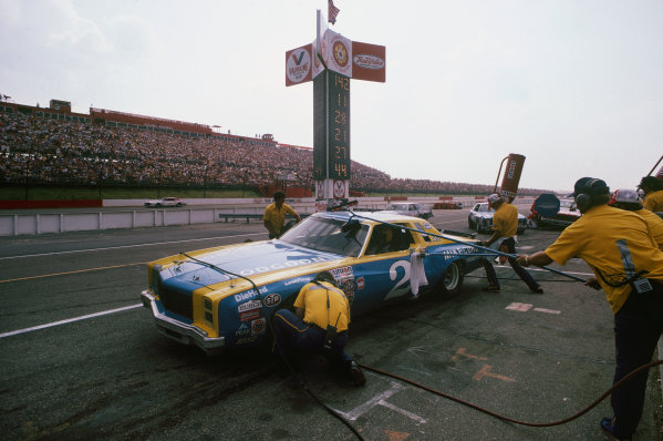 Pocono Raceway, Pennsylvania, USA. 27th July 1980. Rd 19.Dale Earnhardt (Chevrolet), 4th position, pit stop, action.World Copyright: LAT Photographic.Ref: Colour Transparency.