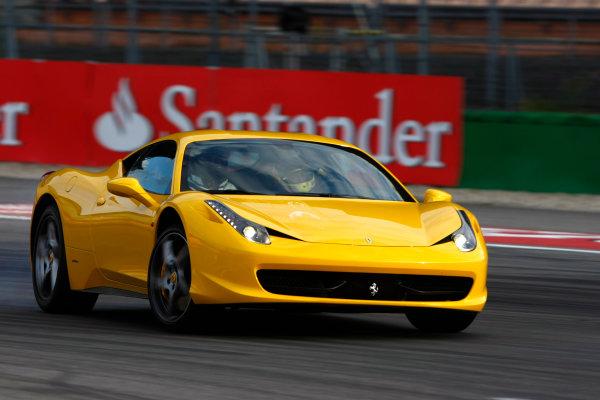 Hockenheimring, Hockenheim, Germany24th July 2010Fernando Alonso, Ferrari F10, gives somebody a passenger ride in a Ferrari. Action. Atmosphere.World Copyright: Charles Coates/LAT Photographicref: Digital Image _26Y4342