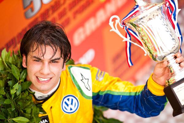 Formula Three. 16th - 19th November 2011. Circuit de Guia, Macau. Felipe Nasr, Carlin celebrates on the podium after the qualifying race. Portrait. World Copyright: Drew Gibson/LAT Photographic. ref: Digital Image _Y2Z6376