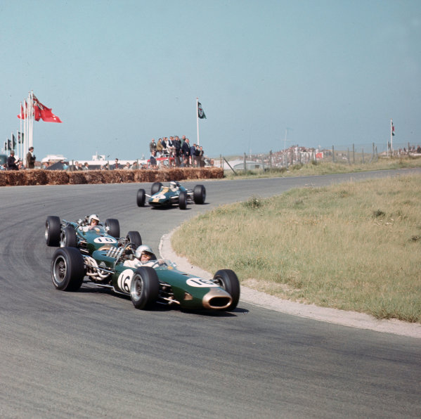 Zandvoort, Holland.22-24 July 1966.Jack Brabham (Brabham BT19 Repco) leads Denny Hulme (Brabham BT20 Repco) and Jim Clark (Lotus 33 Climax). Brabham and Clark finished in 1st and 3rd positions respectively.Ref-3/2305.World Copyright - LAT Photographic