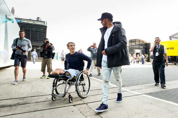 Silverstone, Northamptonshire, UK.  Friday 14 July 2017. Lewis Hamilton, Mercedes AMG, talks with racing driver Billy Monger. World Copyright: Charles Coates/LAT Images  ref: Digital Image AN7T7447