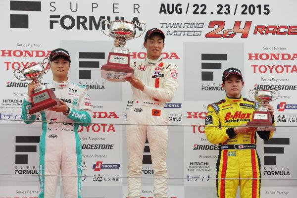 2015 Japanese Formula 3 Championship. Motegi, Japan. 22nd - 23rd August 2015. Rd 14 & 15..  Winner Nirei Fukuzumi ( #7 HFDP RACING F312 ) 2nd position Kenta Yamashita ( #36 PETRONAS TOM'S F312 ) 3rd position Mitsunori Takaboshi ( #23 B-MAX NDDP F3 ) podium, portrait.   World Copyright: Yasushi IshiharaLAT Photographic. Ref: 2015JF3_Rd14&15_006