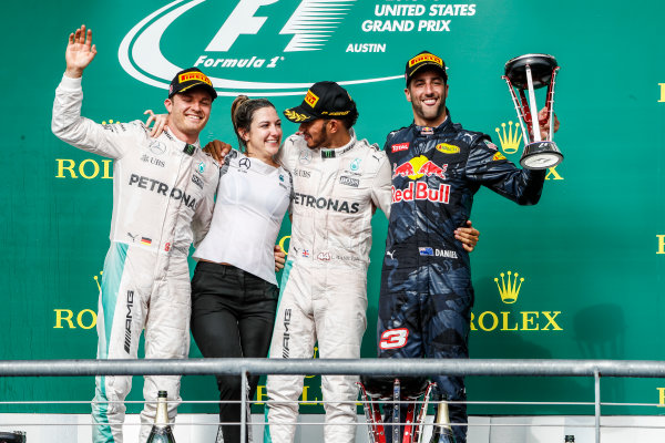 Circuit of the Americas, Austin Texas, USA. Sunday 23 October 2016. Nico Rosberg, Mercedes AMG, 2nd Position, Victoria Vowles, Partner Services Director, Mercedes AMG, Lewis Hamilton, Mercedes AMG, 1st Position, and Daniel Ricciardo, Red Bull Racing, 3rd Position, on the podium. World Copyright: Glenn Dunbar/LAT Photographic ref: Digital Image _31I5268