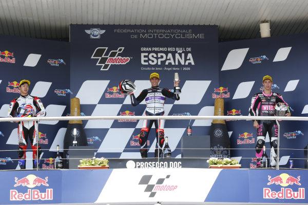 Podium: race winner Albert Arenas, Aspar Team, second place Ai Ogura, Honda Team Asia, third place Tony Arbolino, Snipers Team podium.