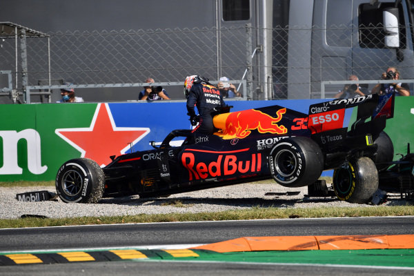 Max Verstappen, Red Bull Racing, climbs out of his car after colliding with Sir Lewis Hamilton, Mercedes W12