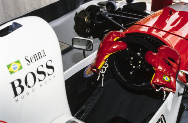 Boxing gloves on the steering wheel of Ayrton Senna's McLaren MP4/8 Ford, a reference to Senna's confrontation with Eddie Irvine in the preceding round in Japan.