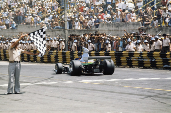 Emerson Fittipaldi takes the chequered flag to finish his first race with the Copersucar-Fittipaldi team. He finished in 13th position.