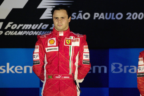 An emotional Felipe Massa listens to the national anthem during podium ceremony.