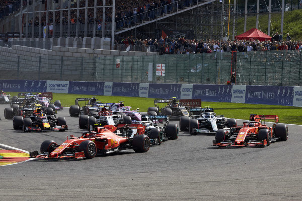 Charles Leclerc, Ferrari SF90, leads Sebastian Vettel, Ferrari SF90, Lewis Hamilton, Mercedes AMG F1 W10, Valtteri Bottas, Mercedes AMG W10, Kimi Raikkonen, Alfa Romeo Racing C38, and the rest of the field at the start