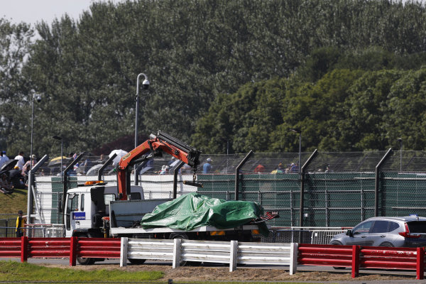 The car of Max Verstappen, Red Bull Racing RB16B, is returned to the garage on a truck
