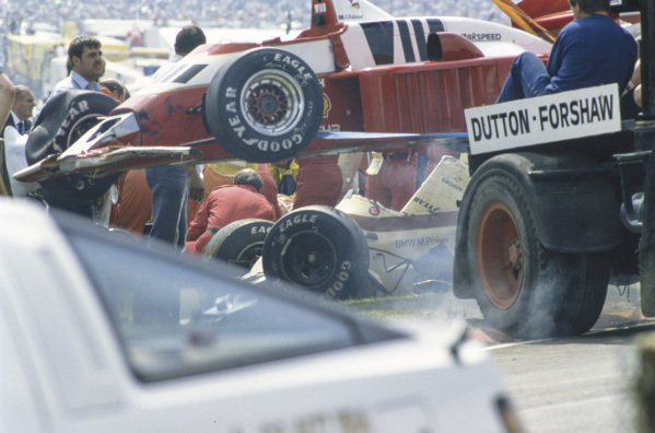 Mechanics recover Jonathan Palmer's Zakspeed 861, and an Arrows A8 BMW, following a collision.