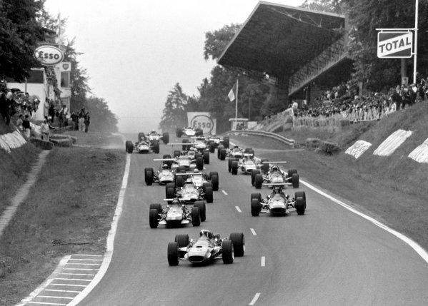 1968 French Grand Prix.Rouen-les-Essarts, France. 7 July 1968.Jackie Stewart (Matra MS10-Ford Cosworth) leads Jochen Rindt (#2, Brabham BT26-Repco), Jacky Ickx (Ferrari 312), Denny Hulme (McLaren M7A-Ford Cosworth), Chris Amon (Ferrari 312), John Surtees (Honda RA301) and Bruce McLaren (McLaren M7A-Ford Cosworth) at the start. Ickx finished in 1st position.World Copyright: LAT PhotographicRef: Black & print