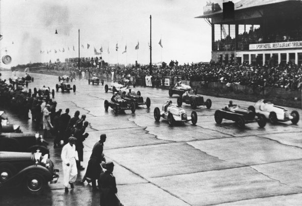 Nurburgring, Germany. 28 July 1935. Tazio Nuvolari (Alfa Romeo Tipo-B P3), 1st position, leads off at the start from the middle of the front row, action.  World Copyright: LAT Photographic. Ref:  S65-1579.