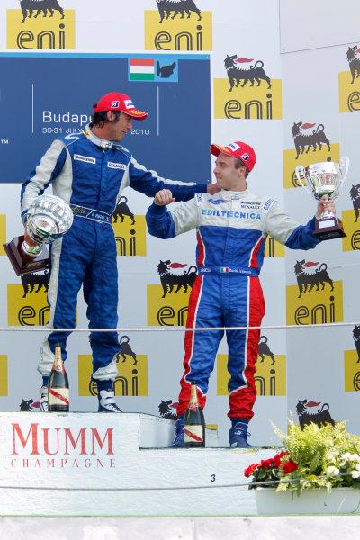 Hungaroring, Budapest, Hungary. 1st August.Sunday Race.Giacomo Ricci (ITA, DPR) celebrates his victory on the podium with Davide Valsecchi (ITA, iSport International).Photo: Andrew Ferraro/GP2 Media Service.Ref: __Q0C7972 jpg