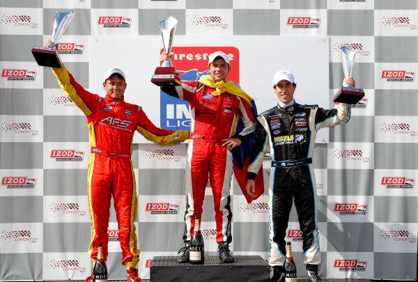 20-21 July, 2012, Edmonton, Alberta CACarlos Munoz, Sebastian Saavedra and Esteban Guerrieri celebrate on the podium.(c)2012, Phillip AbbottLAT Photo USA