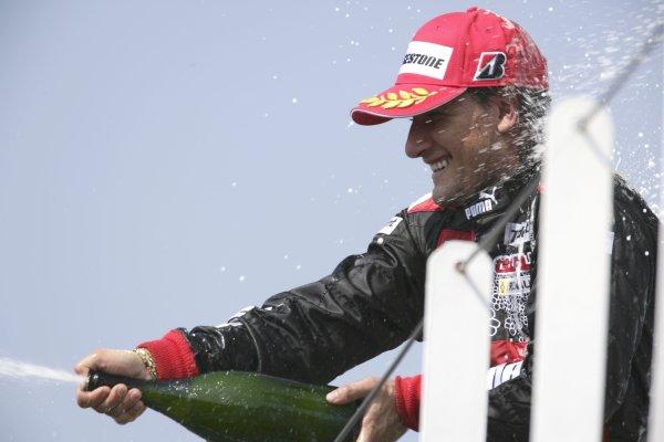 2006 GP2 Series. Round 7 . Magny-Cours, France. 16th July.Sunday RaceGiorgio Pantano (ITA, FMS International). celebrates victory on the podium.World Copyright: Charles CoatesGP2 Series Media Service. ref: Digital Image ZK5Y9446