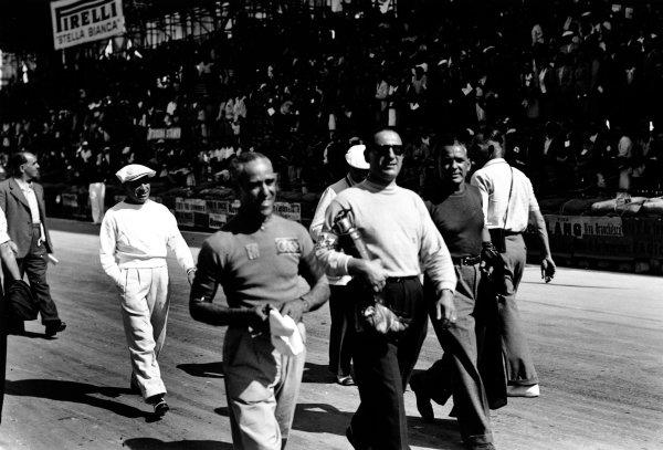 Bremgarten, Berne, Switzerland. 21 August 1938.Tazio Nuvolari, Auto Union D, 9th position, on the grid before the race, portrait.World Copyright: Robert Fellowes/LAT PhotographicRef: 38SUI