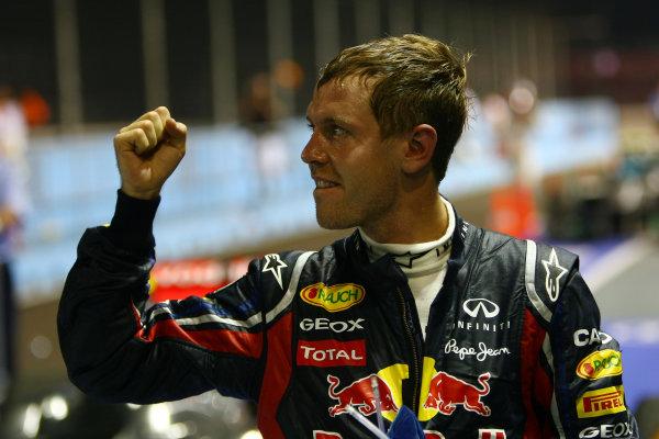 Marina Bay Circuit, Singapore.25th September 2011.Sebastian Vettel, Red Bull Racing RB7 Renault, 1st position, celebrates victory in Parc Ferme. Portrait. Finish. World Copyright: Andy Hone/LAT Photographicref: Digital Image CSP28790