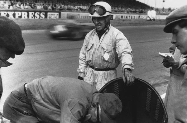 1956 British Grand Prix. Silverstone, England. 14th July 1956. Robert Manzon (Gordini 32), 10th position, portrait.  World Copyright: LAT Photographic.  Ref:  B/W Print.