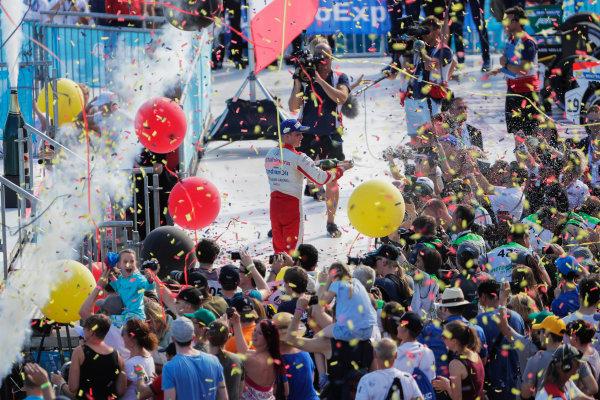2016/2017 FIA Formula E Championship. Round 8 - Berlin ePrix, Tempelhof Airport, Berlin, Germany. Sunday 11 June 2017. Felix Rosenqvist (SWE), Mahindra Racing, Spark-Mahindra, Mahindra M3ELECTRO, sprays the champagne on the podium. Photo: Zak Mauger/LAT/Formula E ref: Digital Image _56I5859