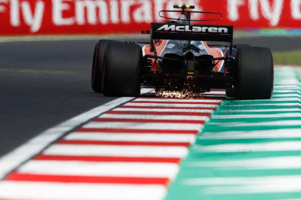 Hungaroring, Budapest, Hungary.  Friday 28 July 2017. Stoffel Vandoorne, McLaren MCL32 Honda, strikes up sparks. World Copyright: Glenn Dunbar/LAT Images  ref: Digital Image _X4I0068
