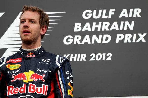 Bahrain International Circuit, Sakhir, Bahrain22nd April 2012Sebastian Vettel, Red Bull Racing, 1st position, celebrates on the podium.World Copyright: Andy Hone/LAT Photographicref: Digital Image HONY8636