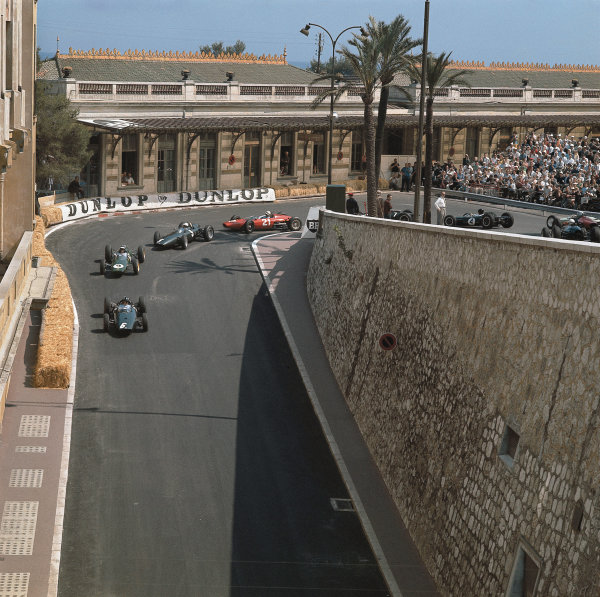 Monte Carlo, Monaco. 23-26 May 1963.  Graham Hill (BRM P57) leads Jim Clark (Lotus 25-Climax), Richie Ginther (BRM P57), John Surtees (Ferrari Dino 156), Bruce McLaren (Cooper T66-Climax) and Dan Gurney (Brabham BT7-Climax) at the start. Hill finished in 1st position.  Ref: MotorSport catalogue page 17. World Copyright: LAT Photographic .