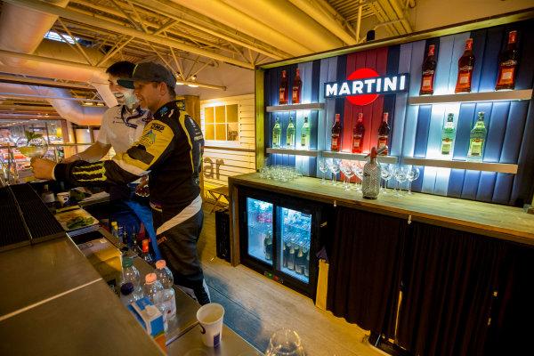 Autosport International Exhibition.  National Exhibition Centre, Birmingham, UK. Sunday 17 January 2016.  Petter Solberg learns how to mix Martini cocktails on the Williams motorhome. World Copyright: Zak Mauger/LAT Photographic. ref: Digital Image _L0U9439