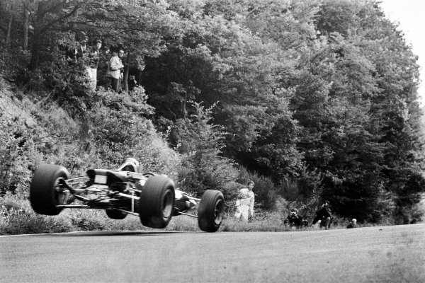 1967 German Grand Prix. Nurburgring, Germany. 4th - 6th August 1967. Jochen Rindt (Cooper T86-Maserati), retired, standing to the side, watching the cars get airborne at the Flugplatz section of the track, action.  World Copyright: LAT Photographic.  Ref:  608C - 28.