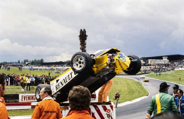 René Arnoux's wrecked Renault RE20 is recovered by marshals.
