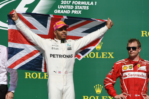 Race winner Lewis Hamilton (GBR) Mercedes AMG F1 celebrates on the podium with the union flag and Kimi Raikkonen (FIN) Ferrari at Formula One World Championship, Rd17, United States Grand Prix, Race, Circuit of the Americas, Austin, Texas, USA, Sunday 22 October 2017.