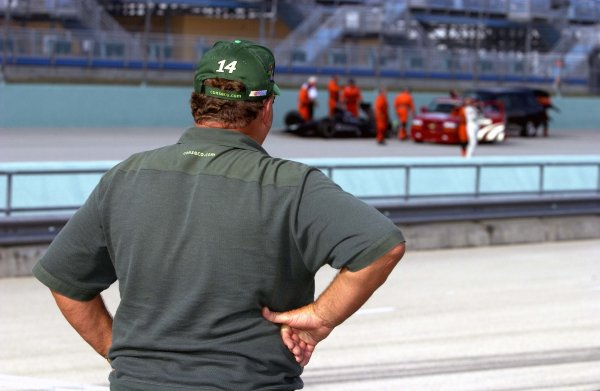 2003 IRL IndyCar Homestead, 2/28-3/2,2003, Homestead-Miami Speedway, USA A J. Foyt looks on with disgust at the crash scene of grandson A J. IV along the main straight.World Copyright-F Peirce Williams 2003 LAT Photographicref: Digital Image Only