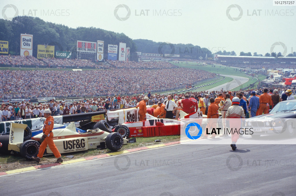 1986 British Grand Prix.Brands Hatch, England.11-13 July 1986.Jacques Laffite is trapped in his Ligier JS27 Renault, after a nine car accident at the start, which caused the race to be stopped.Ref-86 GB 17.World Copyright - LAT Photographic