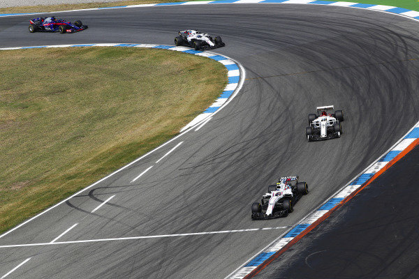 Sergey Sirotkin, Williams FW41 Mercedes, leads Marcus Ericsson, Sauber C37 Ferrari, Lance Stroll, Williams FW41 Mercedes and Brendon Hartley, Toro Rosso STR13 Honda.