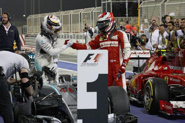 Lewis Hamilton, Mercedes and Kimi Räikkönen, Ferrari celebrate in parc ferme.